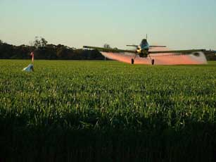 Plane Spraying Fertilizer